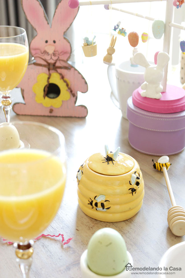 pink rabbits and yellow and white china for an Easter tablescape