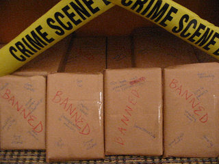books wrapped in brown paper with banned written across them