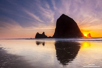 Sunset behind Haystack Rock at Cannon Beach, Oregon.