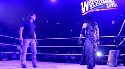 shawn michaels y the undertaker en el cuadrilatero