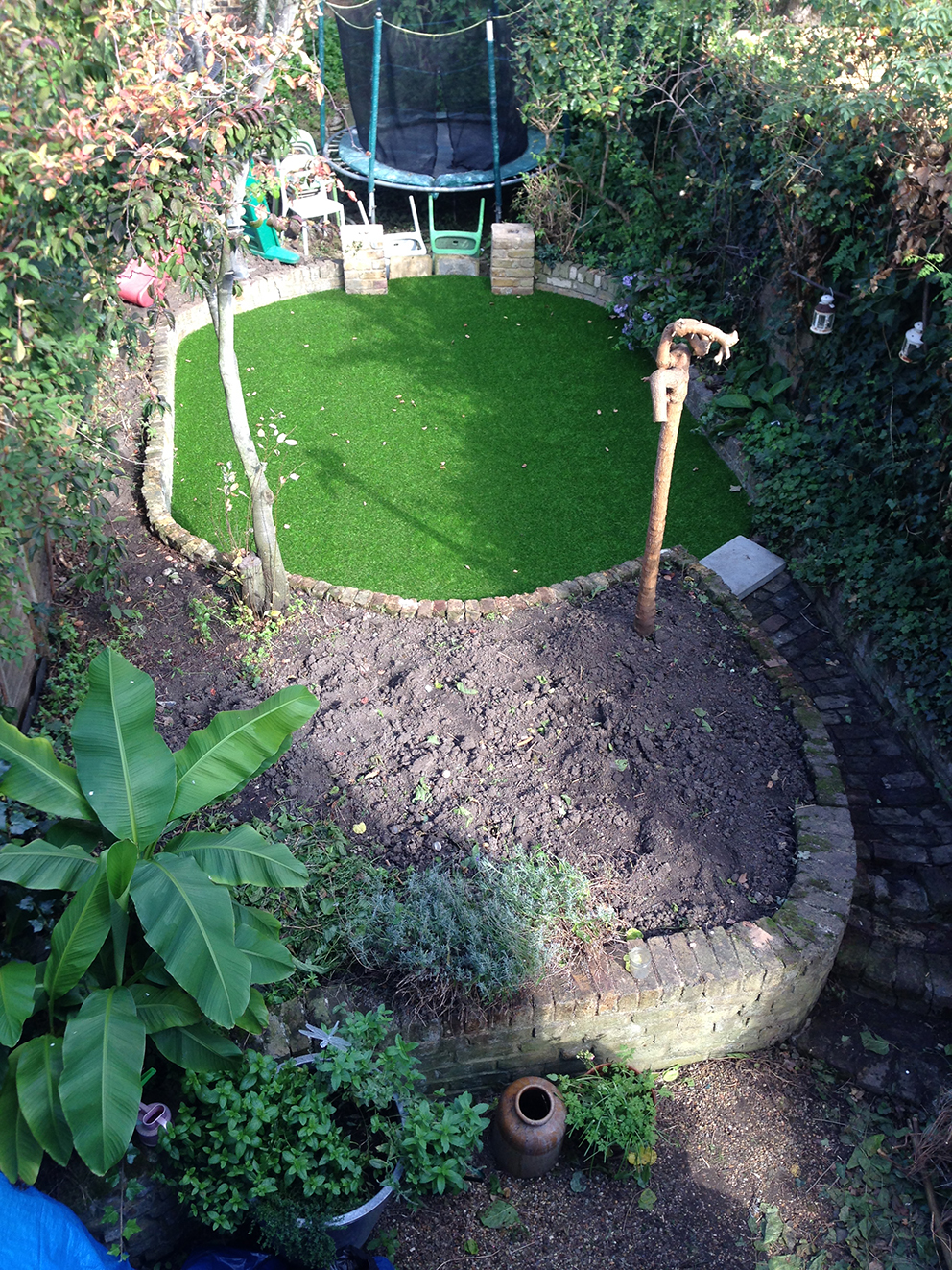 Garden from above with fake turf - French For Pineapple Blog