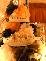 The wedding centerpieces are constructed of paper and yarn flowers