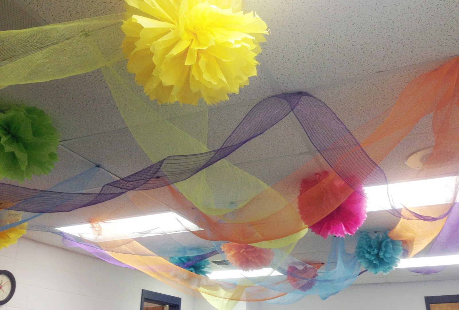Dancing Commas :: Workshop of Wonders VBS :: Tissue paper pom poms and decorative mesh hung from ceiling