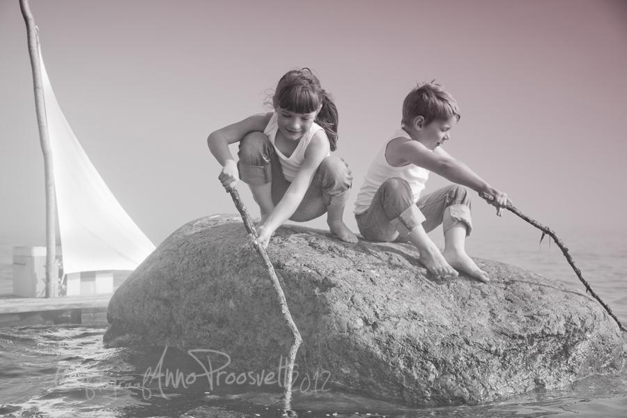 poiss-tydruk-kivil-pyyavad-kala