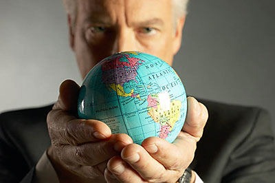 man holding earth globe