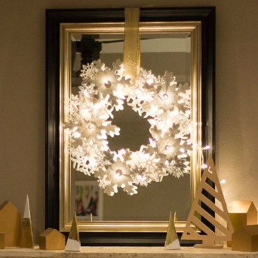 This DIY snowflake wreath GLOWS!
