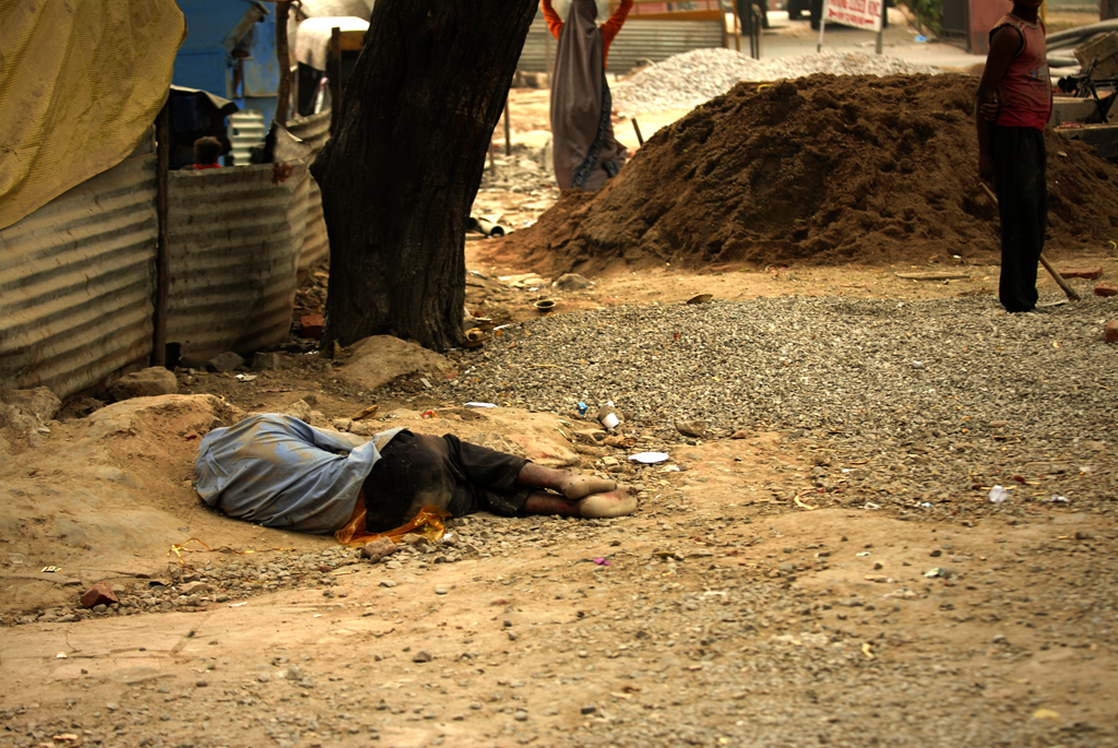 Poverty photo of a man in India.