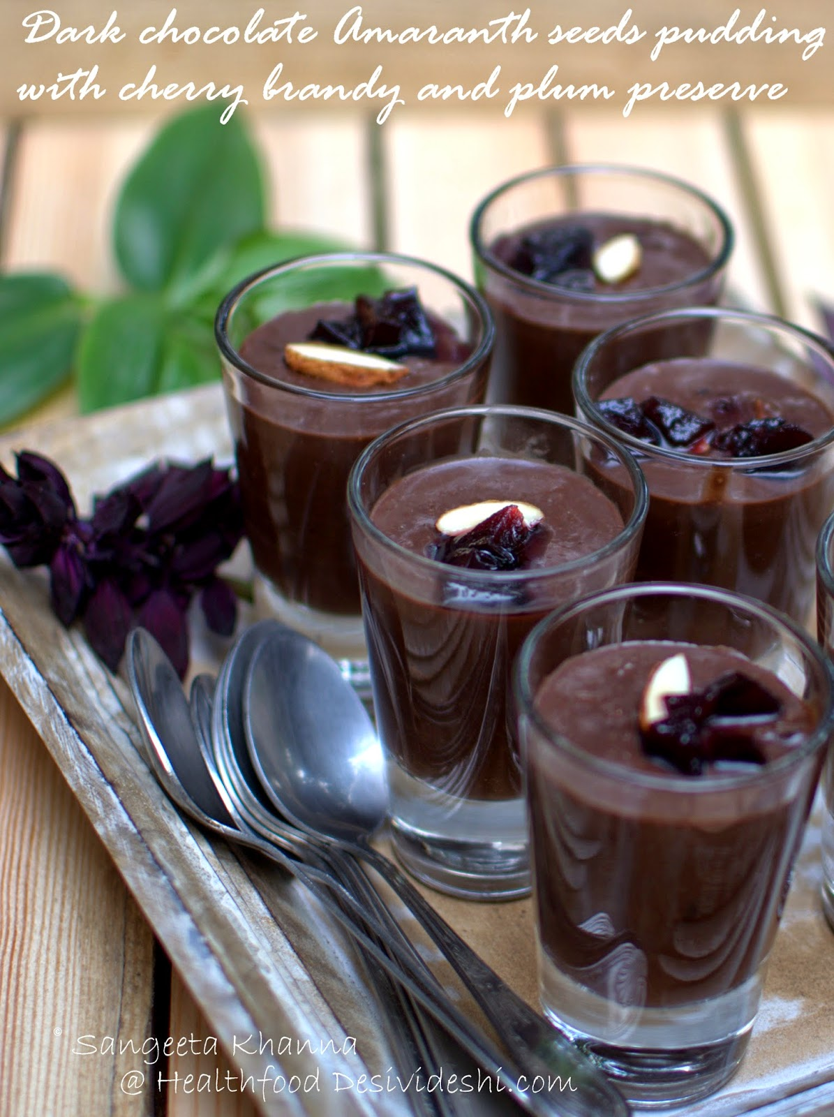 gluten free dark chocolate pudding with amaranth, balsamic plums preserve and cherry brandy