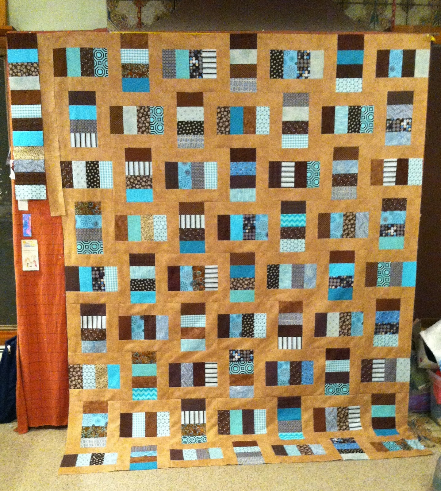 Framed Rectangles Quilt in Blue and Teal with pieced borders- can be adjusted to use jelly roll strips