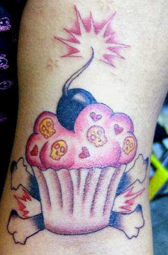 Girly deathful cupcake tattoo
