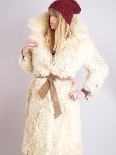 Vintage 1970's cream colored bohemian style mongolian fur coat with brown leather belt
