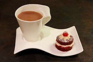 Cup of tea and mini red velvet cake
