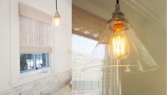 pendant lights hang over the kitchen sink counter area above and