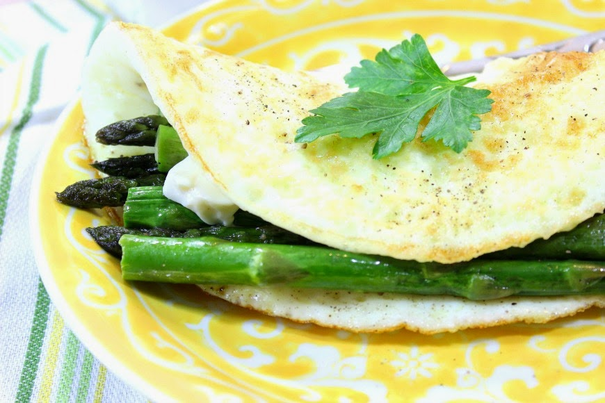 Egg white omelet with asparagus and creamy low-fat cheese is so delicious you'll never miss the yolks. - Kudos Kitchen by Renee
