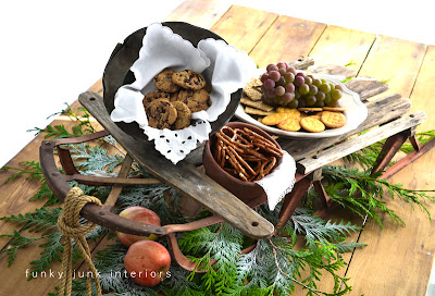 A vintage sleigh food centrepiece for Christmas via Funky Junk Interiors