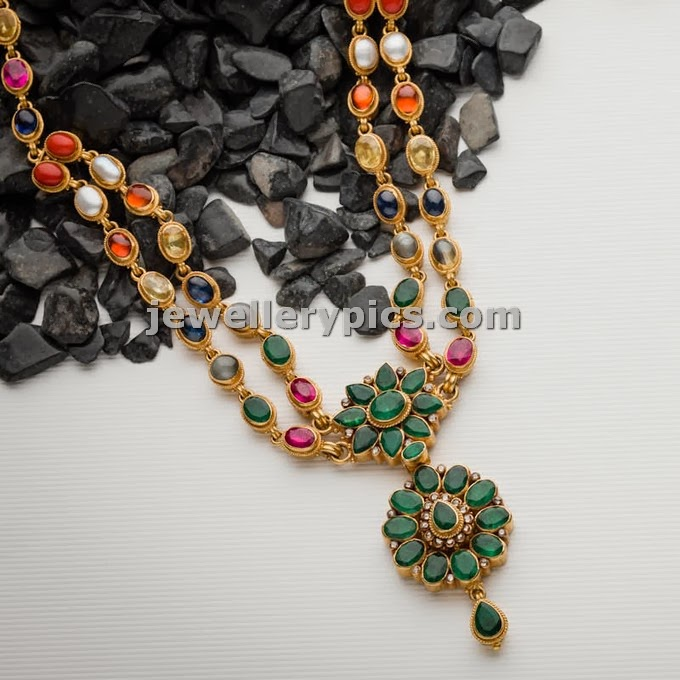 traditional gewellery with emerald pendent and gemstone chain