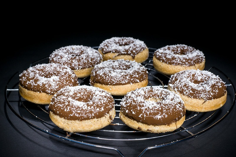 Vegan cocos donuts with chocolate and cocos on black