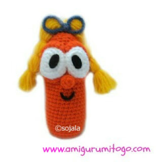 orange crochet carrot with pigtails