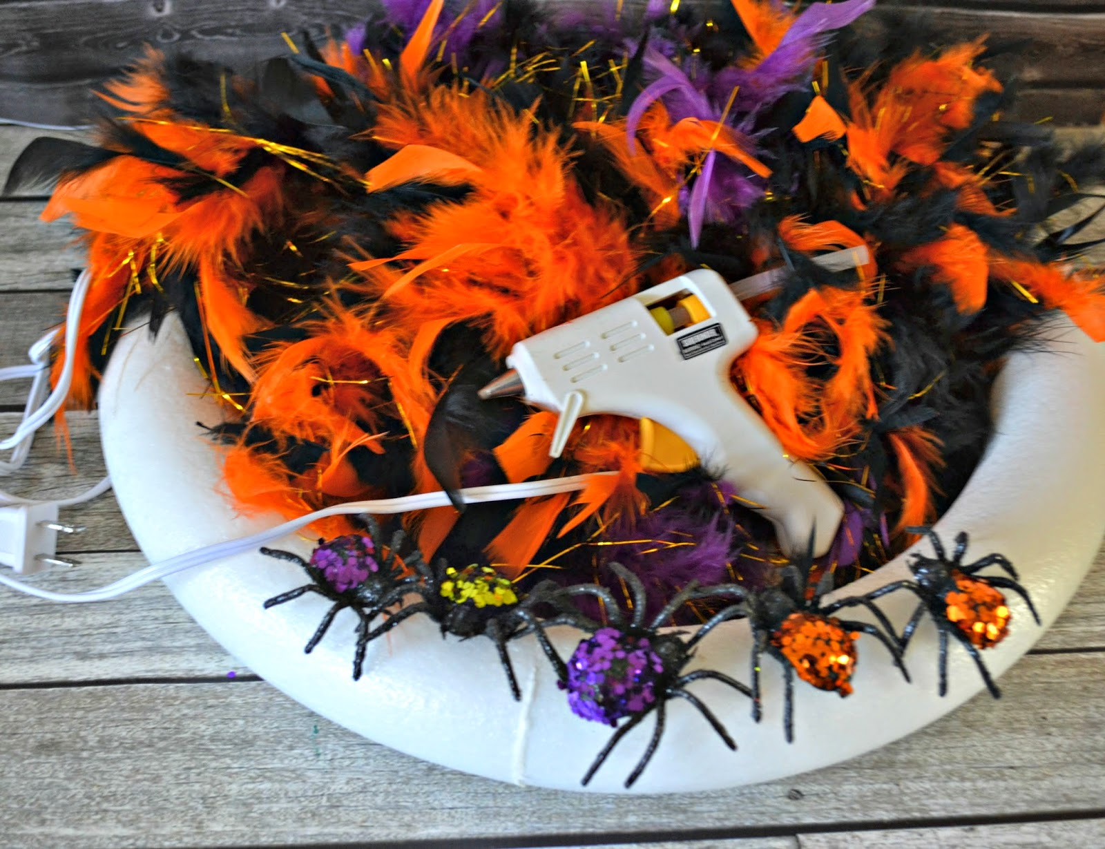 Feathered Halloween Door Wreath #DIY.  Easy Halloween Decorations. DIY Halloween Door Wreath.  Crafts with Boas.  Halloween decorations.  Halloween door decor.  Halloween Home Decor.  Door Wreath.