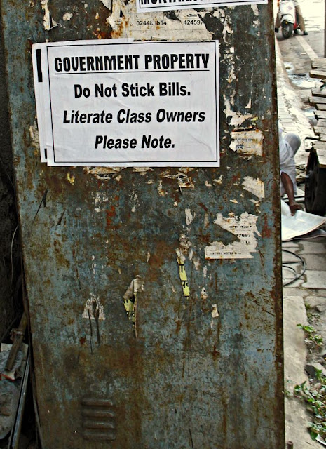 Stick no bills sign