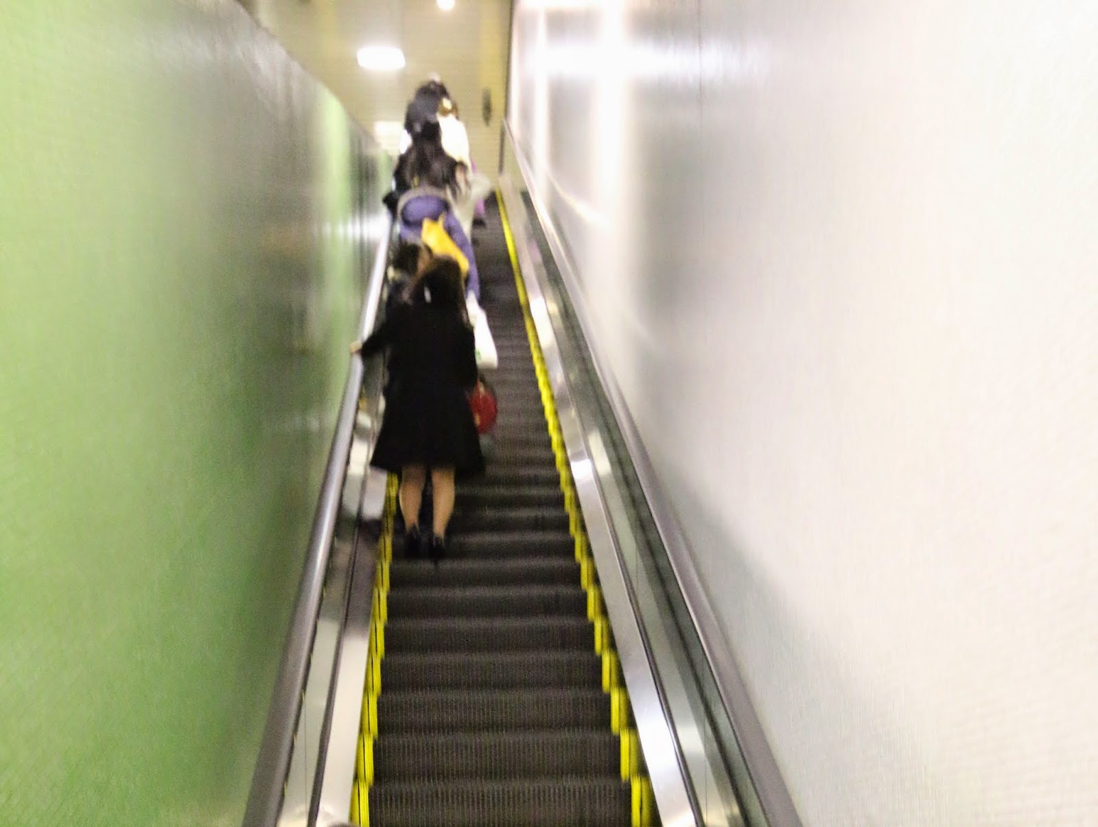 Japanese Escalator Etiquette is by standing on the left side in Tokyo while standing on the right side in Osaka in order to allow others passing by