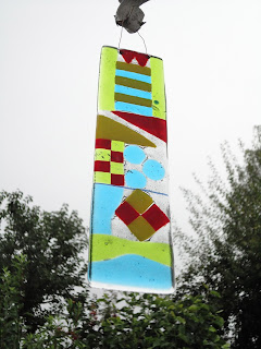 Lucinda's fused glass sun catcher outside