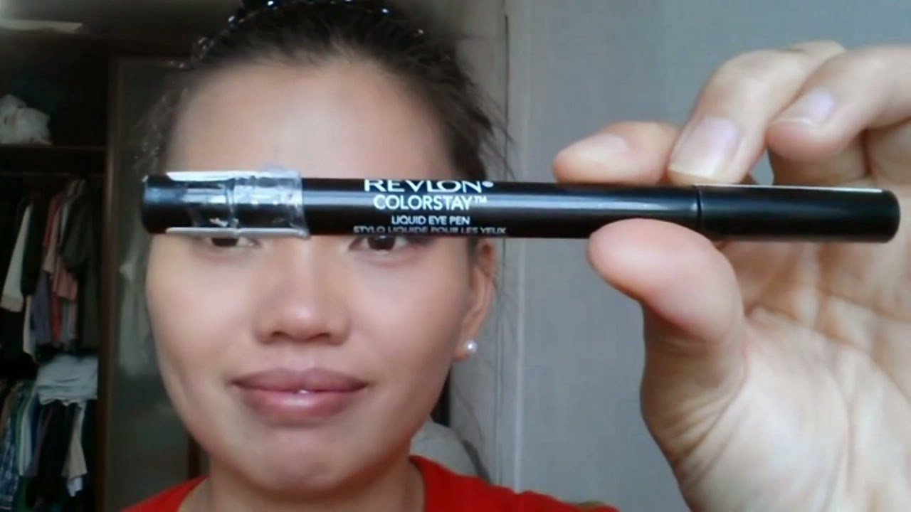 Black Smokey Eyes Makeup Tutorial. Lady showing Revlon Colorstay liquid eyeliner pen.