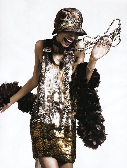 Flapper in gold sequins, dancing.