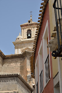 Bell tower of church in Caravaca on medieval street