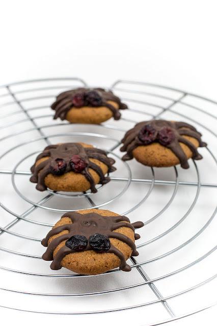 Vegan almonds cookies halloween spiders focus on first