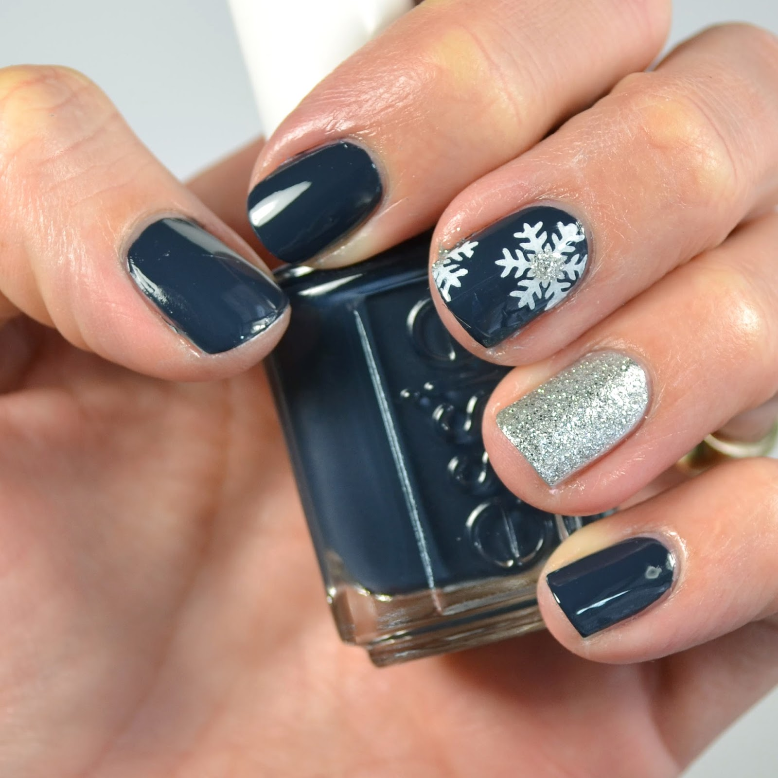 Go Polished Navy And Silver Snowflake Nail Design