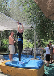 Unhooking the safety lines below the flying trapeze net.
