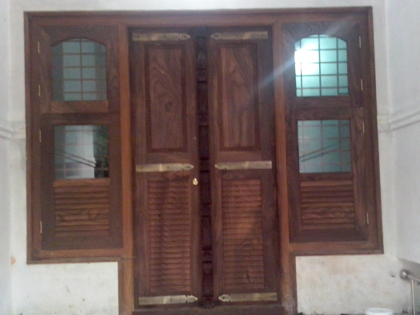 Kerala style carpenter works and designs kerala style for Main door with french window