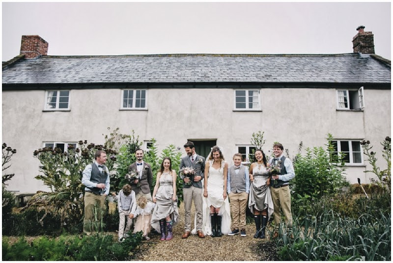 Bridal party in front of River Cottage farmhouse