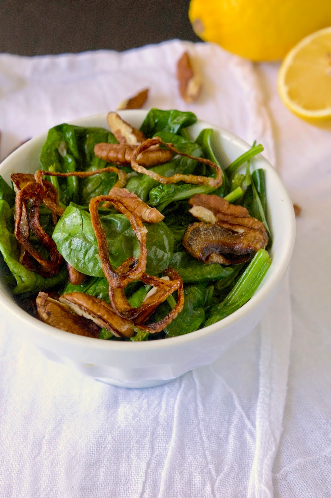 Sautéed spinach with crispy shallots and pecans