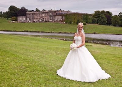 Bride with Wynyard Hall and lake in the background