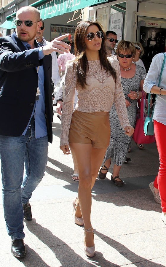 Eva Longoria with her bodyguard leading the way