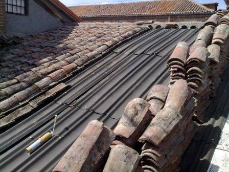 Arreglar tejado comunidad tejados de naves y locales en for Tejados de madera con tela asfaltica