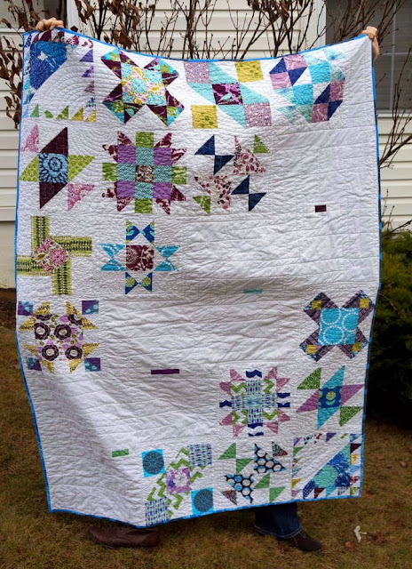 http://quiltyhabit.blogspot.com/2014/01/sister-quilt-1-finished-quilt.html
