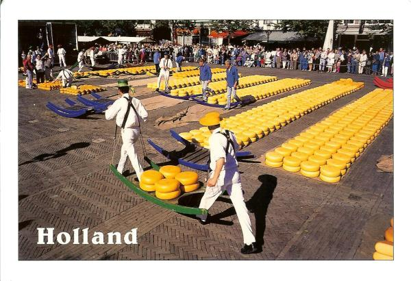cheeses laid out in the square at Alkmaar with traditional cheese carriers