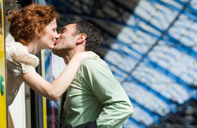How To Cope With An Absent Partner - man kissing woman - say good bye