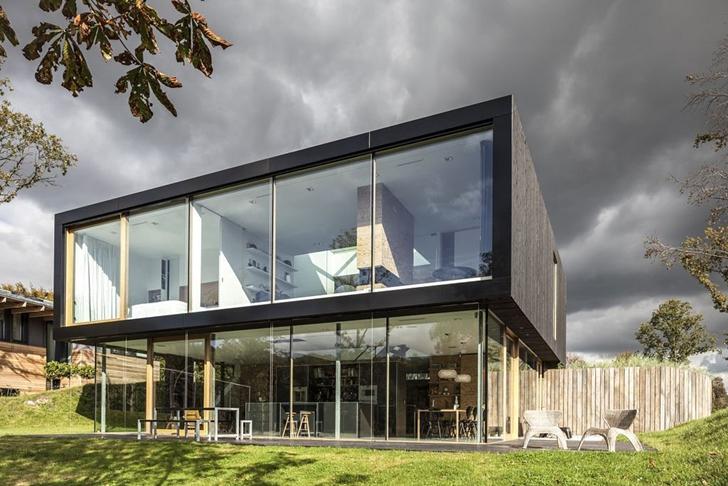 Modern Villa V by Paul de Ruiter Architects from backyard