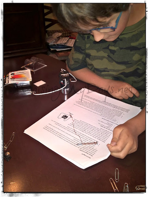 boy reading instructions for experiment