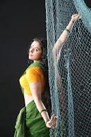 swetha menon spicy hot exposing photo shoot thaaram tamil movie stills