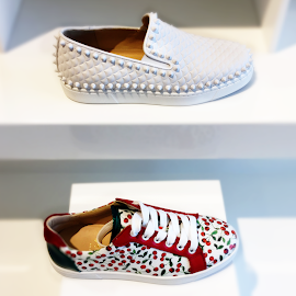French Designer Christian Loubotin Pik Boat Flat and sneakers.