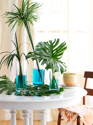 leafy green table tinted water and tropical foliage make a dramatic