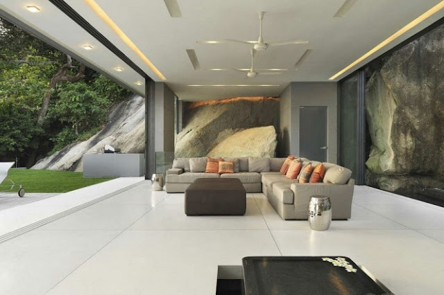 Photo of the living room with white floor and white ceiling along with the glass walls