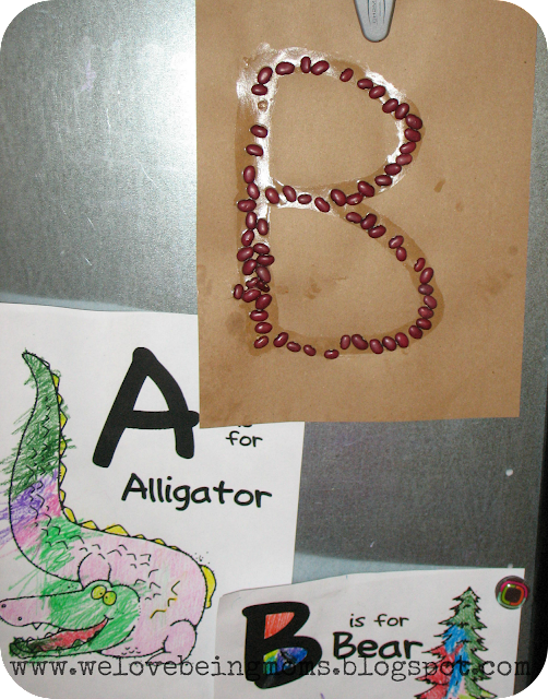 Make the letter b with beans all you need is a sheet of paper glue