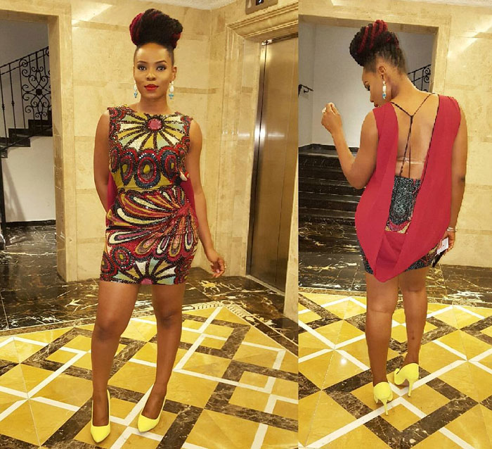 Rate Singer Yemi Alade In Short Showback Gown And Yellow Heels (Photo)