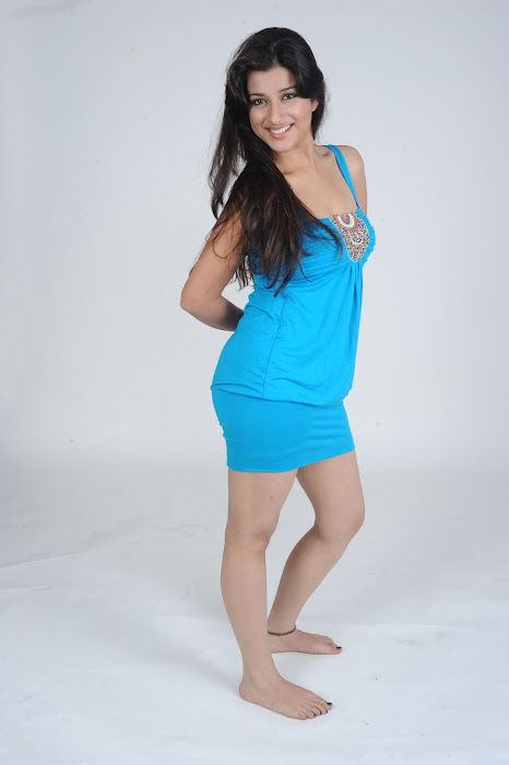 Madhurima in Blue Short Skirt showing her white milky thighs